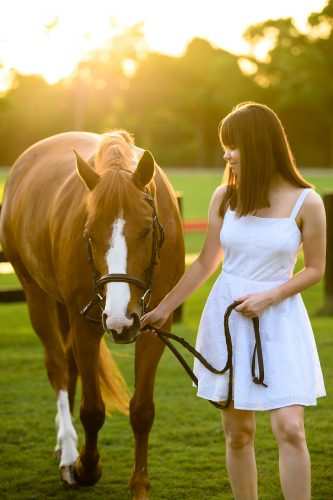 teenager with chestnut horse