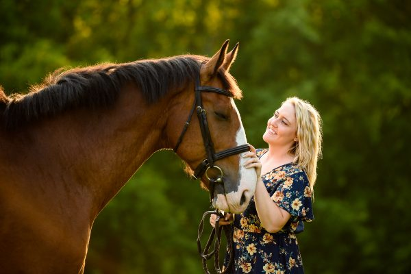 woman with bay horse
