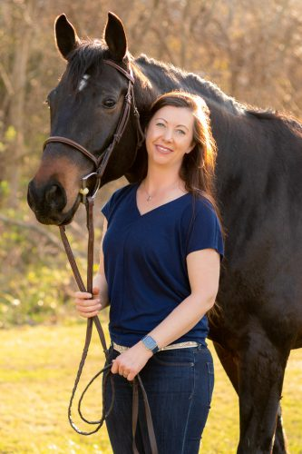 woman and dark bay horse